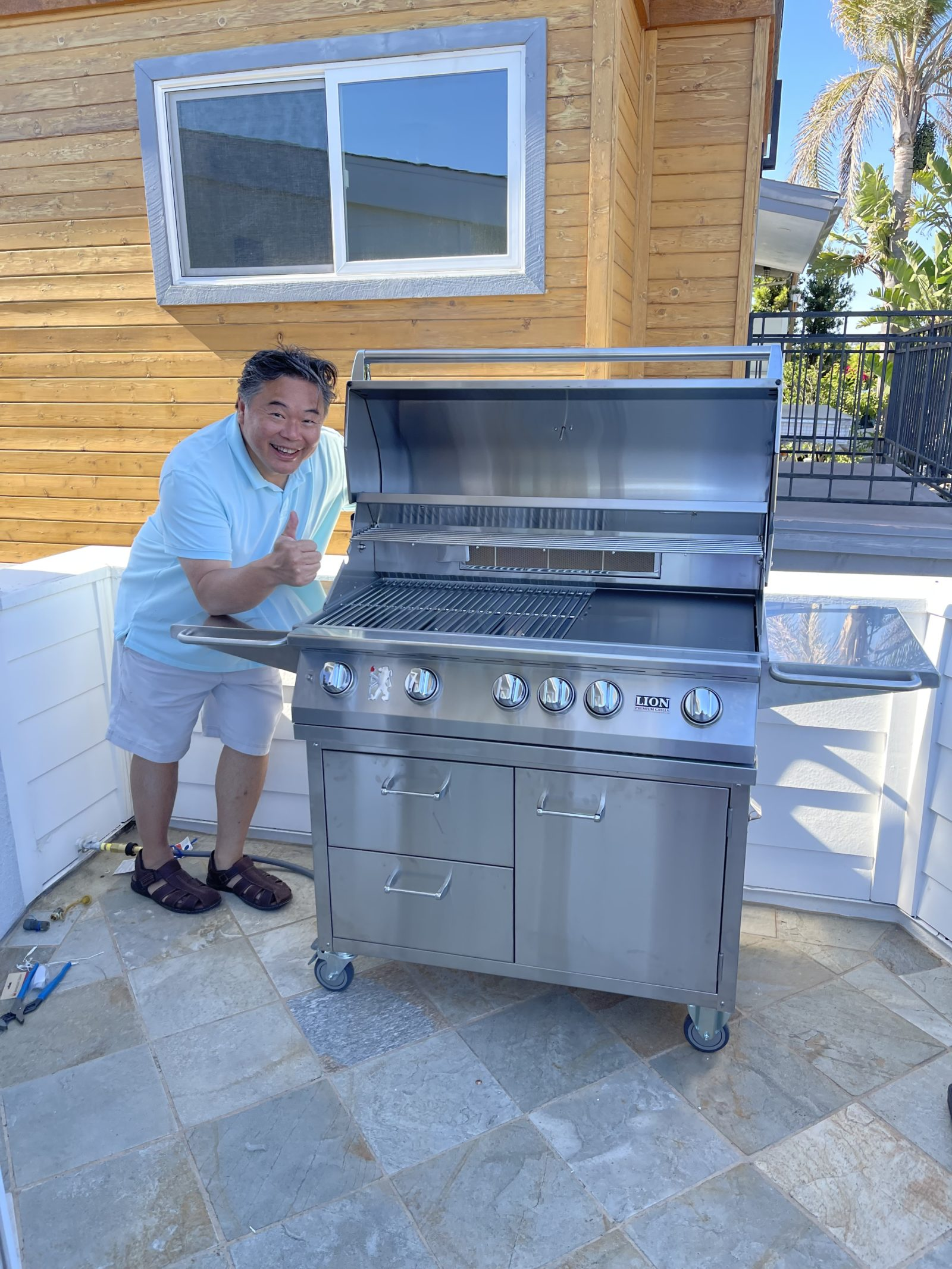 Lion Premium Grills - Happy Customer w/ Grill and Cart