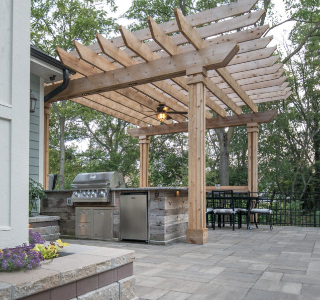 Island & patio by Elemental Landscapes @ Mokena, IL